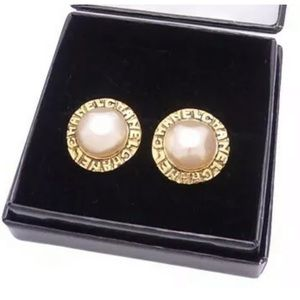 Authentic vintage pearl Chanel stud earrings